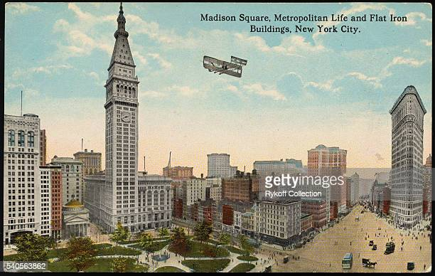 Madison Square Metropolitan Life and Flat Iron Buildings New York City Madison Square showing Fifth Avenue at right crossed by Broadway at 23rd...