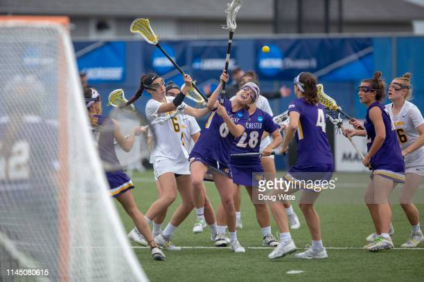 Madison Staska of West Chester fights with Adelphis Chelsea Abreu for control during the Division II Women's Lacrosse Championship held at the GVSU...
