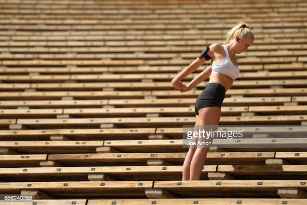 Madison Teter 20 of Arvada stretching during her run at Red Rocks Amphitheater She started thinking about running along with weight's when she came...