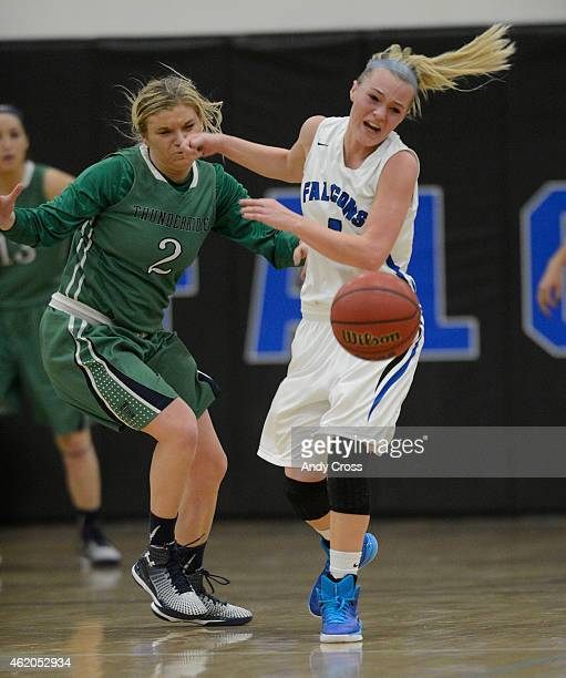 Madison Ward, #2, ThunderRidge and Logan Opheim, #4, Highlands Ranch, go after a loose ball in the second half at Highlands Ranch January 22, 2015....