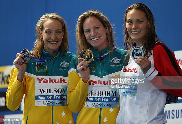 Madison Wilson Emily Seebohm of Australia and Mie Oe Nielsen of Denmark pose with their medals from the Women's 100m Backstroke during day eleven of...