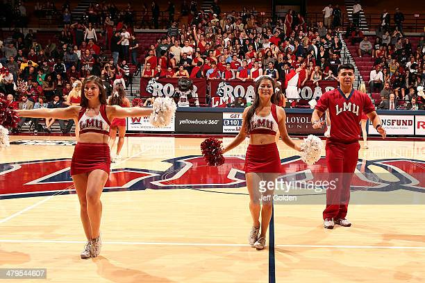 Madison Wright Tessa Soriano and Ricky Leanos of the Loyola Marymount Lions Cheer Team perform during the first half of the game against the...