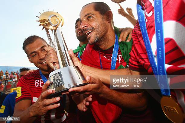 Madjer and Belchior of Portugal celebrate with the trophy after winning the FIFA Beach Soccer World Cup Portugal 2015 Final between Tahiti and...