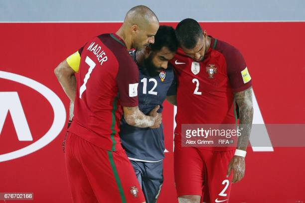 Madjer and Coimbra of Portugal comfort goalkeeper Humaid Jamal of UAE after the FIFA Beach Soccer World Cup Bahamas 2017 group C match between United...