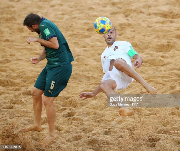 Madjer of Portugal attempts an overhead kick under pressure from Alessio Frainetti of Italy during the FIFA Beach Soccer World Cup Paraguay 2019...