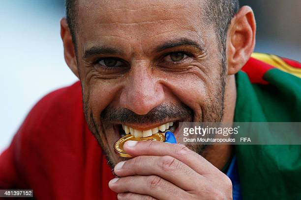 Madjer of Portugal celebrates by biting his gold medal after winning the FIFA Beach Soccer World Cup Final between Tahiti and Portugal held at...