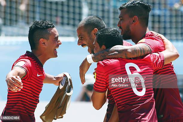 Madjer of Portugal celebrates his team's first goal with team mates during the FIFA Beach Soccer World Cup Portugal 2015 Group A match between...