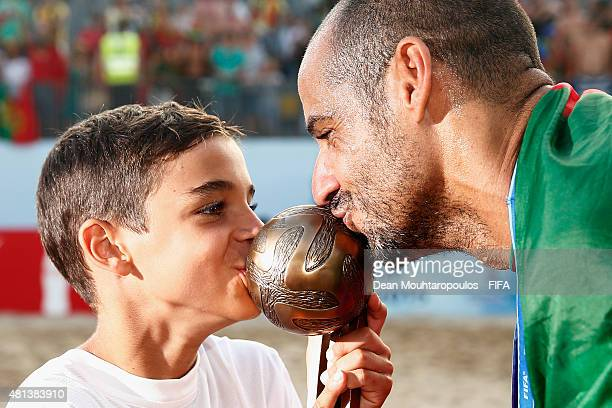 Madjer of Portugal celebrates with his son by kissing the adidas bronze scorer award after winning the FIFA Beach Soccer World Cup Final between...