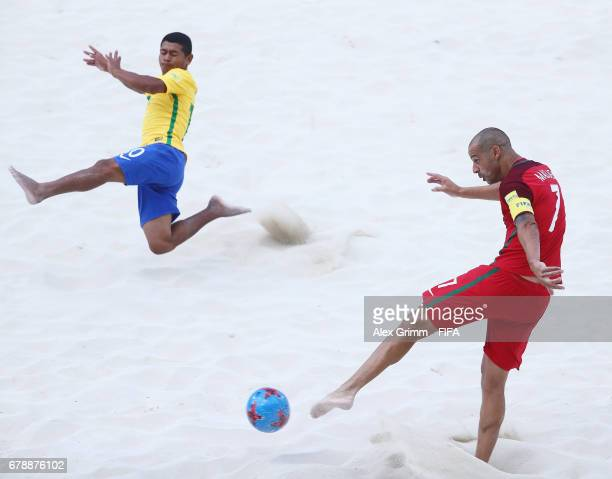 Madjer of Portugal is challenged by Datinha of Brazil during the FIFA Beach Soccer World Cup Bahamas 2017 quarter final match between Brazil and...