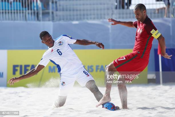 Madjer of Portugal is challenged by Patrick Tepa of Tahiti during the FIFA Beach Soccer World Cup Bahamas 2017 group D match between Brazil and...