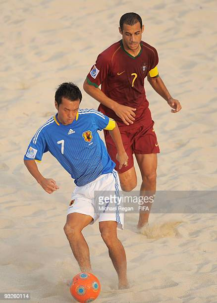 Madjer of Portugal puts pressure on Takeshi Kawaharazuka of Japan during the FIFA Beach Soccer World Cup Quarter Final match between Japan and...