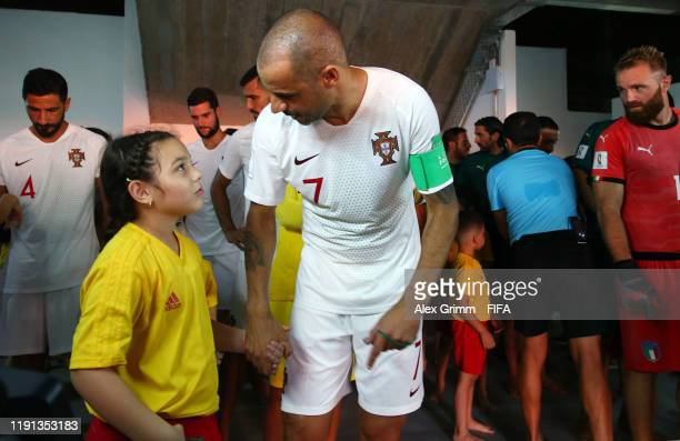 Madjer of Portugal talks to the players escort kid in the tunnel prior to the FIFA Beach Soccer World Cup Paraguay 2019 final between Italy and...