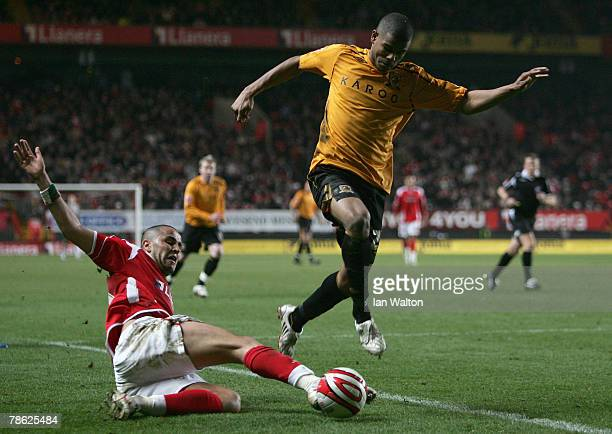 Madjid Bougherra of Charlton Athletic tries to tackle Fraizer Campbell of Hull City during the CocaCola Championship match between Charlton Athletic...
