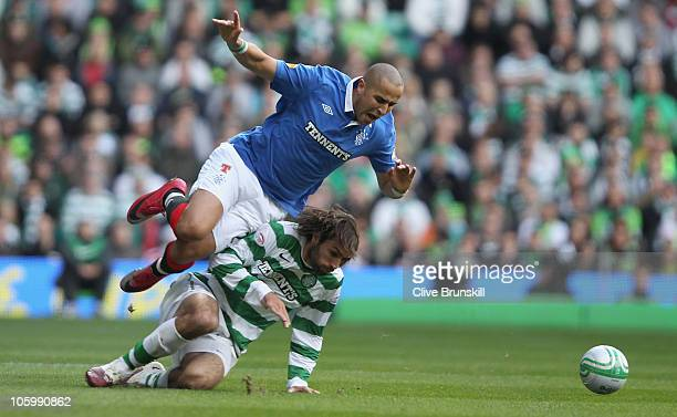 Madjid Bougherra of Rangers is tackled by Georgios Samaras of Celtic during the Clydesdale Bank Premier League match between Celtic and Rangers at...