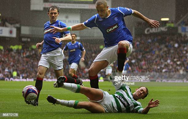 Madjid Bougherra of Rangers tackles Aiden McGeady of Celtic during the Scottish Premier League match between Rangers and Celtic at Ibrox stadium on...