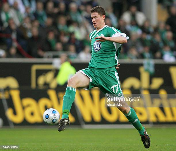 Madlung, Alexander - Football, Defender, VfL Wolfsburg, Germany - in action on the ball