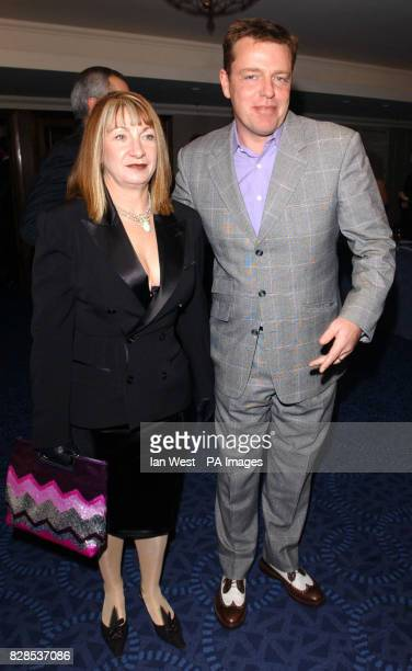 Madness frontman Suggs and his wife Anne McPherson arrive at the Music Industry Trust's Awards and Dinner 2002 at Le Meridien Grosvenor House Park...