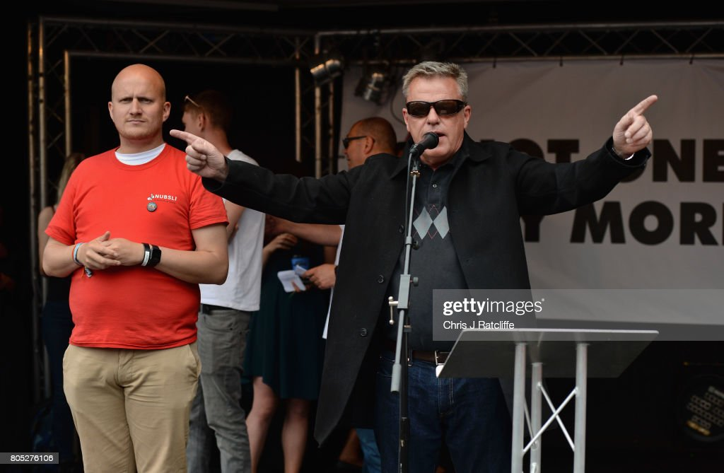 Madness frontman Suggs speaks to demonstrators during the 'Not One Day More' march at Parliament Square on July 1, 2017 in London, England. Thousands of protesters joined the anti-Tory demonstration at BBC Broadcasting House and marched to Parliament Square. The demonstrators were calling for an end to the Conservative Government and policies of austerity.