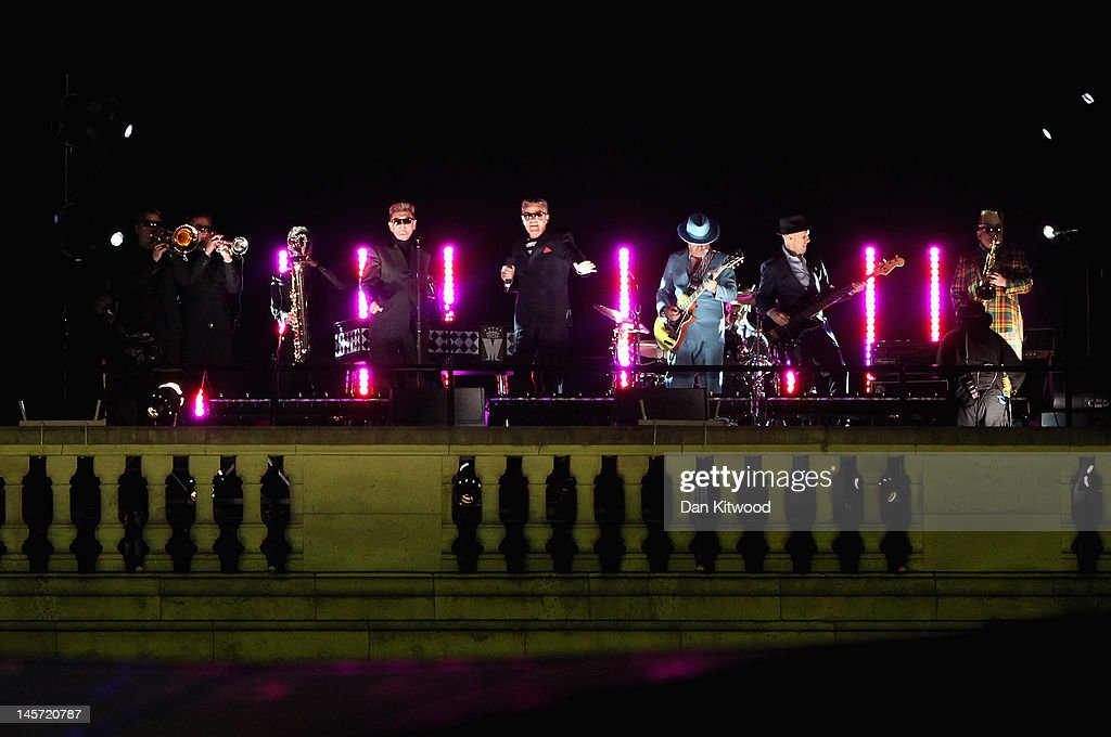 Madness perform during the Diamond Jubilee concert at Buckingham Palace on June 4, 2012 in London, England. For only the second time in its history the UK celebrates the Diamond Jubilee of a monarch. Her Majesty Queen Elizabeth II celebrates the 60th anniversary of her ascension to the throne. Thousands of well-wishers from around the world have flocked to London to witness the spectacle of the weekend's celebrations.
