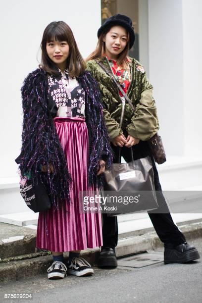 Madoka Fujimoto and Riona Kawase stop for a fashion snap in Harajuku Madoka Fujimoto is wearing a Nice Clip purple and black jacket a vintage...