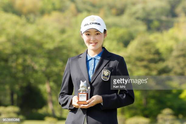 Madoka Kimura of Japan holds the trophy for the leading amateur after final round of the CyberAgent Ladies Golf Tournament at Grand fields Country...