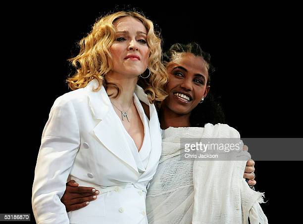 Madonna and 24yearold student Birhan Woldu former Ethiopian famine victim and the inspiration for Live Aid 1985 stand on stage during 'Live 8 London'...