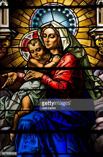 madonna and child stained-glass window in havana, cuba - catholic church christmas stock photos and pictures