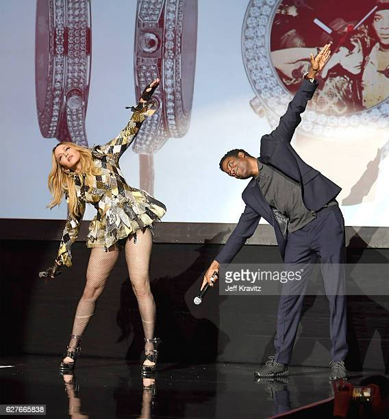 Madonna and Chris Rock on stage during her Evening of Music, Art, Mischief and Performance to Benefit Raising Malawi at Faena Forum on December 2,...