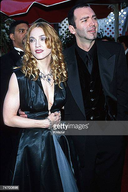 Madonna and Christopher Ciccone during The 70th Annual Academy Awards - Red Carpet at the Shrine Auditorium in Los Angeles, California.