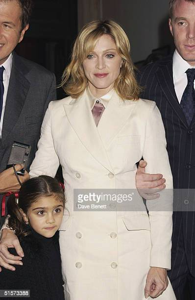 Madonna and daughter Lourdes and Guy Ritchie attend the Mario Testino Exhibition at The National Portrait Gallery on January 30 2002 in London