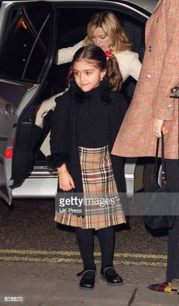 Madonna and daughter Lourdes arrive at the opening of the Mario Testino photography exhibition January 29 2002 at the National Portrait Gallery in...
