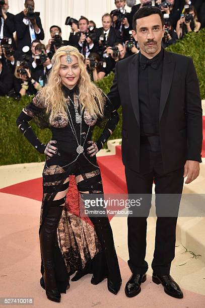 Madonna and fashion designer Riccardo Tisci attend the 'Manus x Machina Fashion In An Age Of Technology' Costume Institute Gala at Metropolitan...