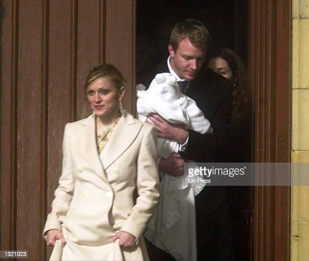 Madonna and Guy Ritchie attend the baptism of their son Rocco at Dornoch Cathedral December 21 2000 in Scotland