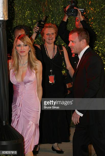 Madonna and Guy Ritchie during 2006 Vanity Fair Oscar Party at Morton's in West Hollywood California United States