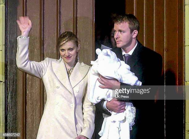 Madonna and Guy Ritchie with their son Rocco at Rocco's Christening Ceremony at Dornoch Cathedral in Scotland on December 21 2000 in Dornoch Scotland