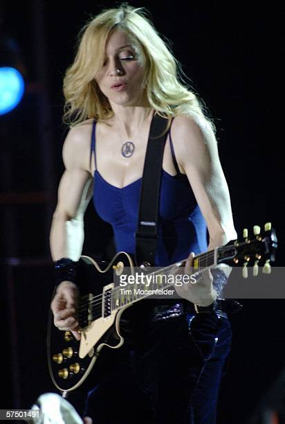 Madonna and her band perform as part of the Coachella Valley Music and Arts Festival at the Empire Polo Fields on April 30 2006 in Indio CA