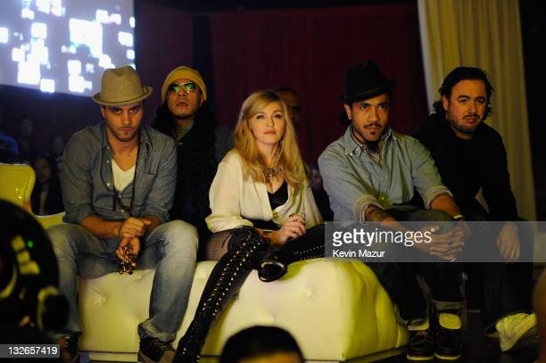 Madonna and her choreographers Rich Tone watch The Smirnoff Nightlife Exchange Project dance competition at Roseland Ballroom on November 12 2011 in...