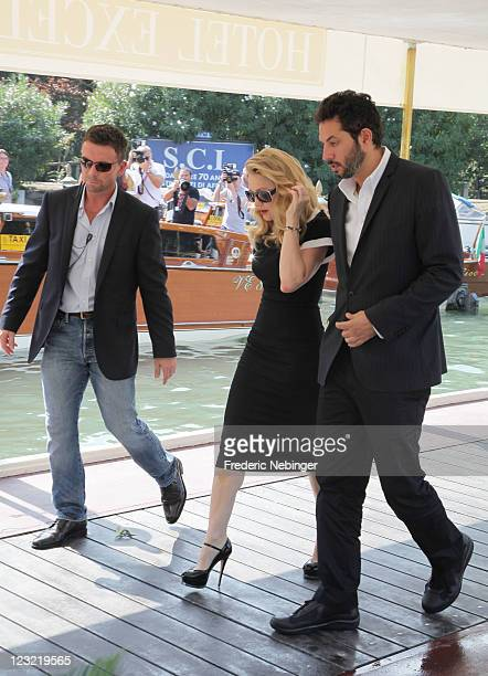 Madonna and her manager Guy Oseary from the film 'WE' arrive at the Hotel Excelsior during the 68th Venice Film Festival on September 1 2011 in...