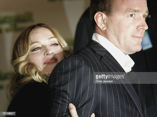Madonna and husband Guy Ritchie arrive at the Arthur And The Invisibles premier at Vue Leicester Square on January 25 2007 in London England