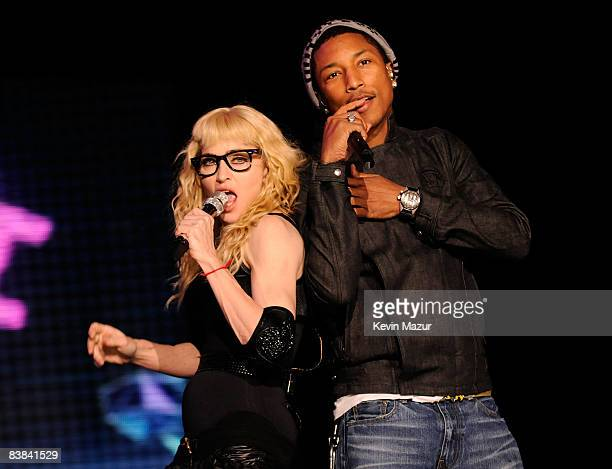 Madonna and Pharrell perform on stage during the ''Sticky Sweet'' tour at Dolphins Stadium on November 26 2008 in Miami