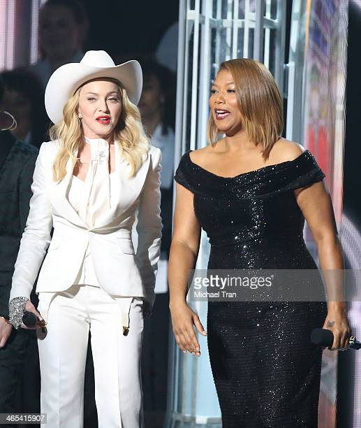Madonna and Queen Latifah perform onstage during the 56th GRAMMY Awards held at Staples Center on January 26 2014 in Los Angeles California