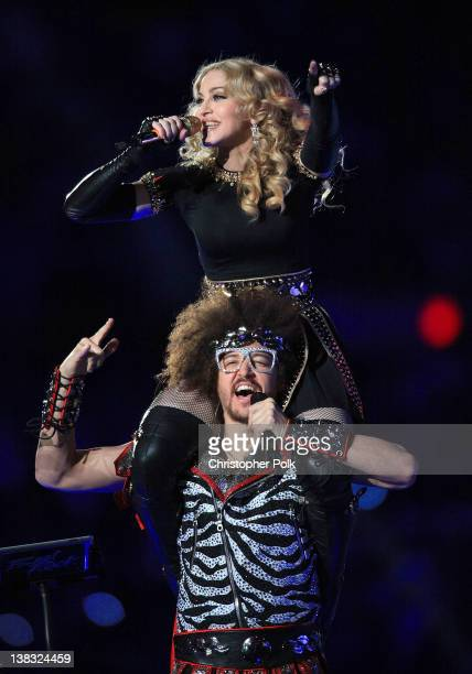 Madonna and Red Foo of LMFAO perform during the Bridgestone Super Bowl XLVI Halftime Show at Lucas Oil Stadium on February 5 2012 in Indianapolis...