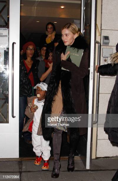 Madonna and son David Banda are seen leaving Kaballah services in Manhattan on January 23 2009 in New York City