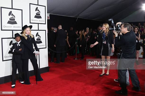 Madonna and son David Banda arrive at the 56th Annual GRAMMY Awards at Staples Center on January 26 2014 in Los Angeles California