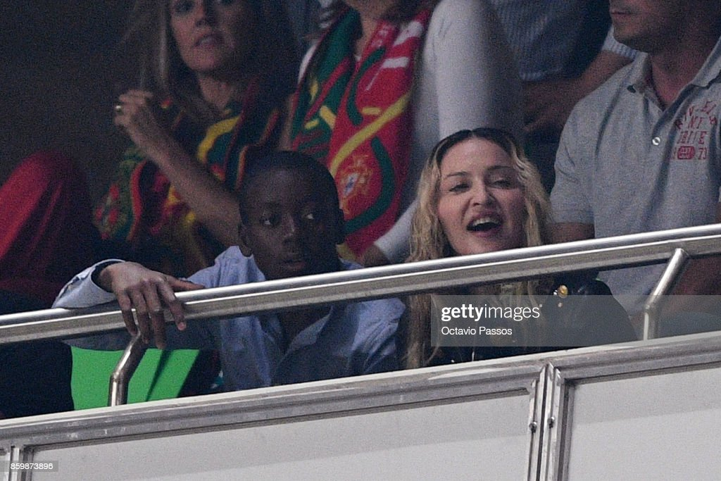 Madonna and son David Banda (L) watch the FIFA 2018 World Cup Qualifier between Portugal and Switzerland at the Luz Stadium on October 10, 2017 in Lisbon, Lisboa.