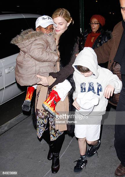Madonna and sons Rocco Ritchie and David Banda attend Kaballah services in Manhattan on January 23 2009 in New York City