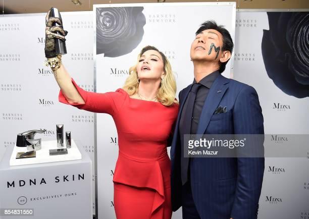 Madonna and Tsuyoshi Matsushita President of MTG Co Ltd launch MDNA SKIN collection at Barneys New York on September 26 2017 in New York City