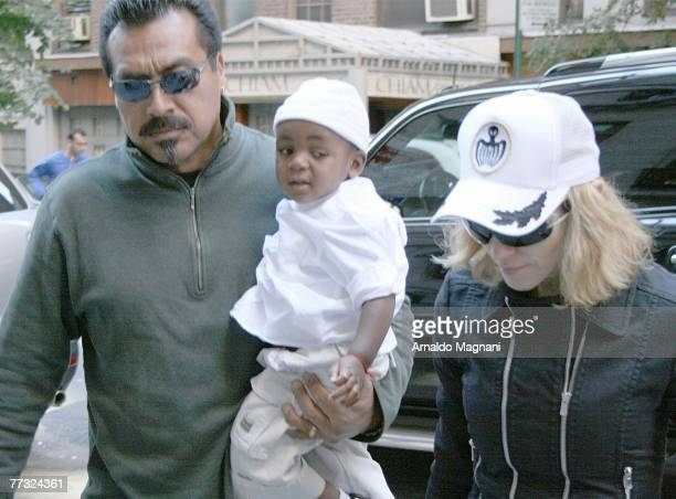 Madonna arrives at a Kabbalah Center with her adopted son David Banda and a bodyguard on October 13 2007 in New York City