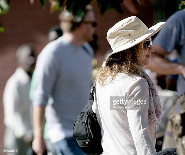 Madonna arrives at one of the Raising Malawi initiative's Mphandula Childcare Centre which supports over 350 Children from the surrounding Namitete...