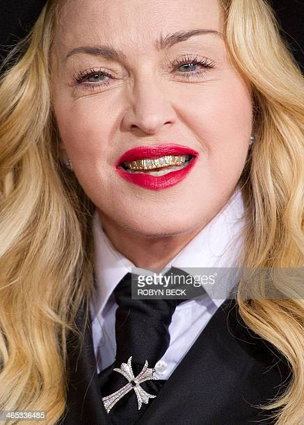 Madonna arrives on the red carpet for the 56th Grammy Awards at the Staples Center in Los Angeles California January 26 2014 AFP PHOTO ROBYN BECK